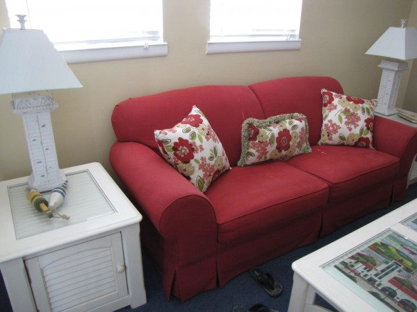 red couch, coastal decor