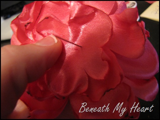 secure fabric flower with needle and thread