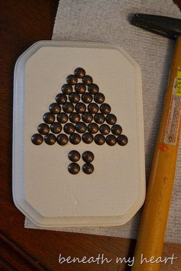 diy ornament with upholstery tacks