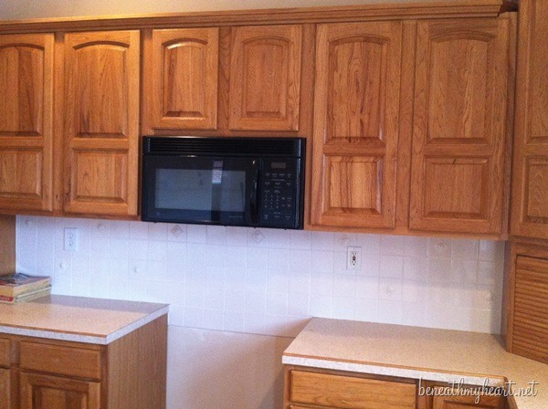 how do i paint my kitchen cabinets painting kitchen cabinets white beneath my 9250
