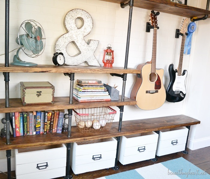 DIY Industrial Shelves {Jonathan's side of the room!}