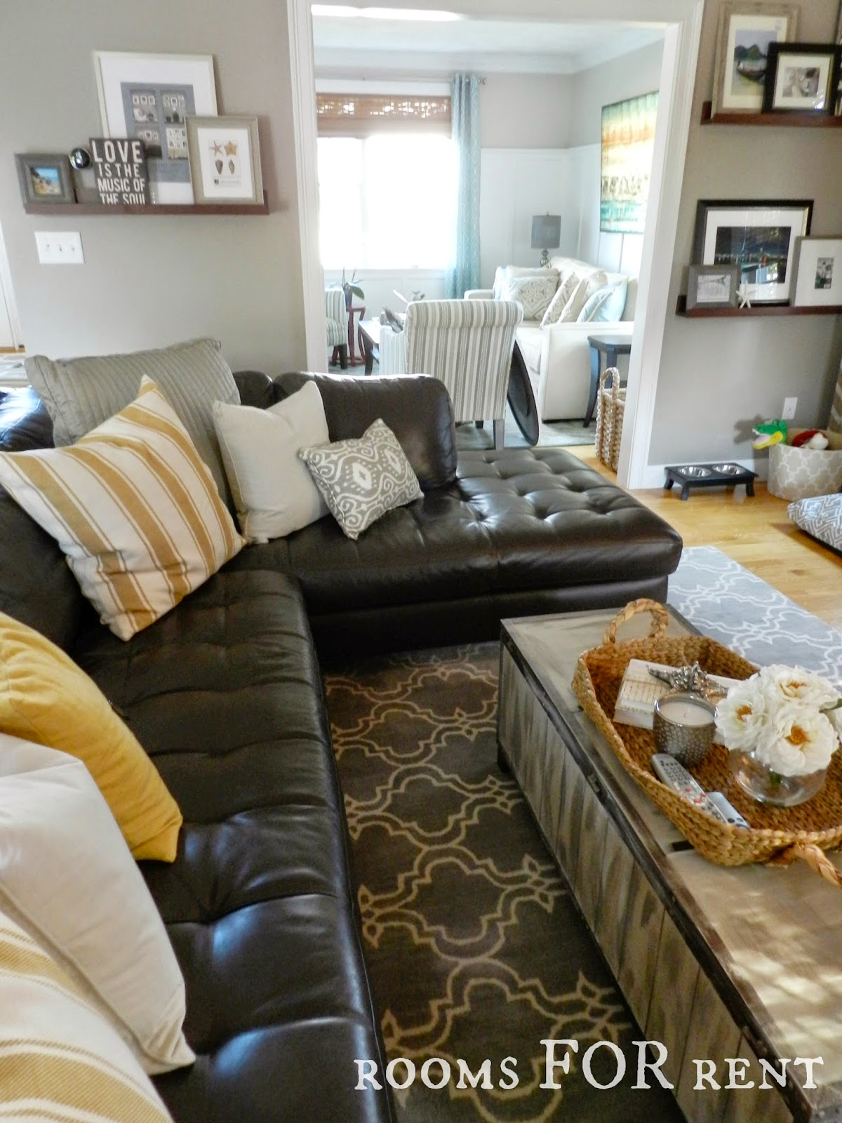 How to style a dark leather sofa den makeover beneath for Leather sofa family room