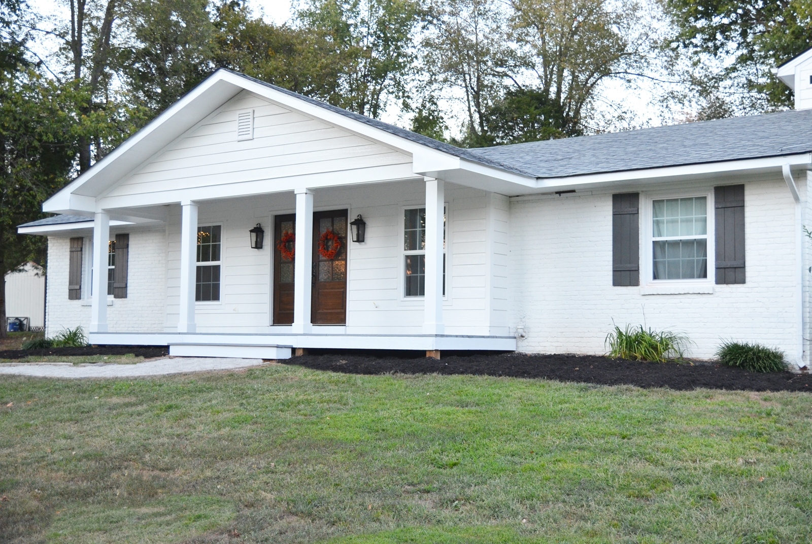 Adding a front porch to a brick ranch beneath my heart for Small brick ranch homes