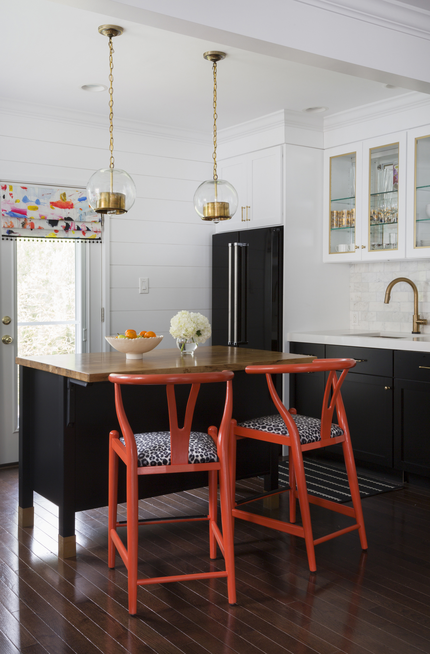 Black-and-White-Kitchen-white-quartz-countertop-marble-backsplash-orange-kitchen-brass-accents-Design-Manifest