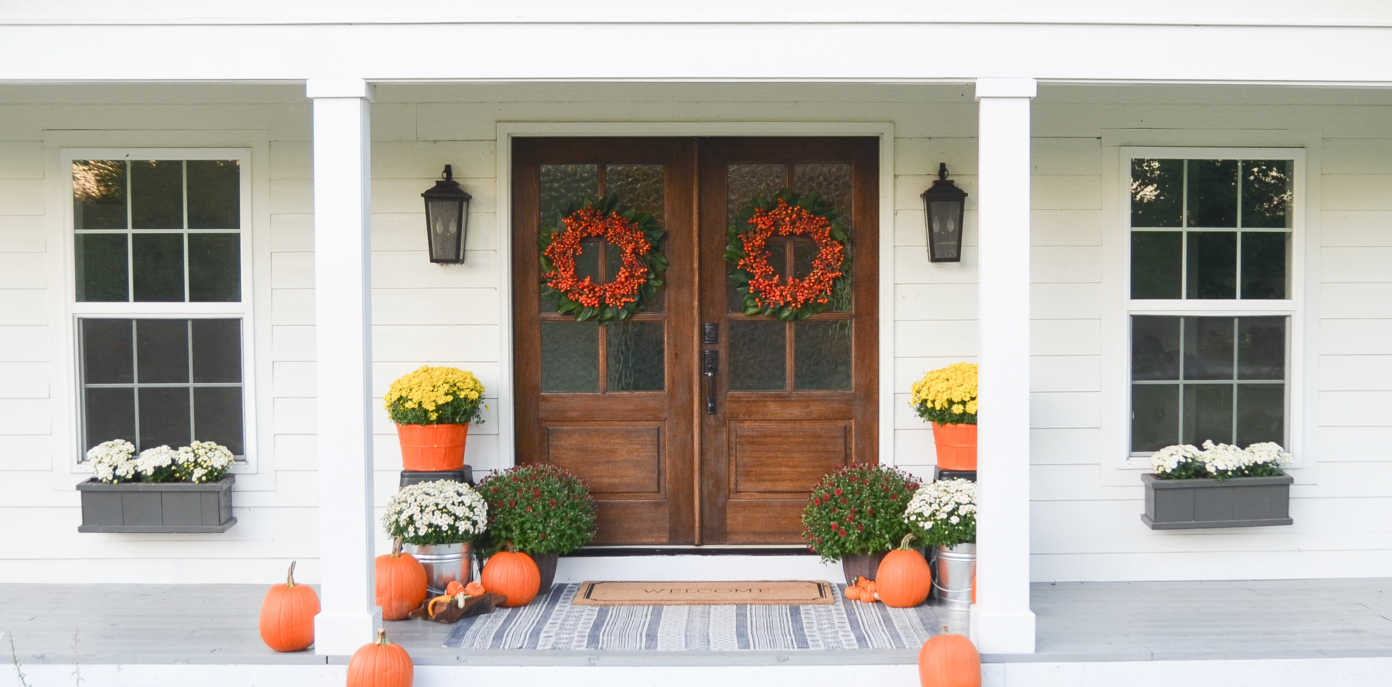 Fall front porch with wreath and pumpkins