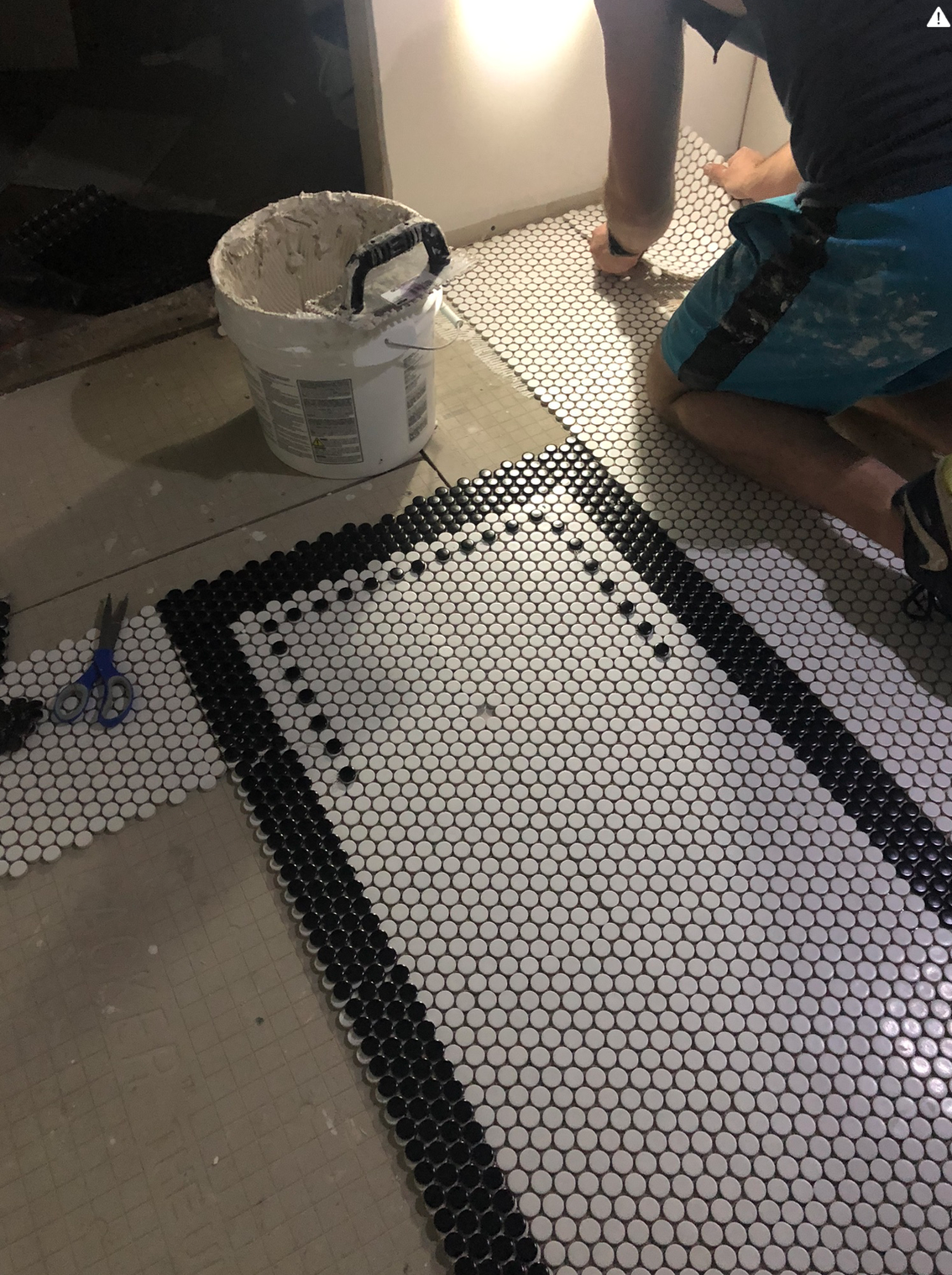 laying a tile rug